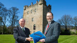 The Earl of Mar, left, hands over Alloa Tower to Sir Kenneth Calman of the National Trust for Scotland.